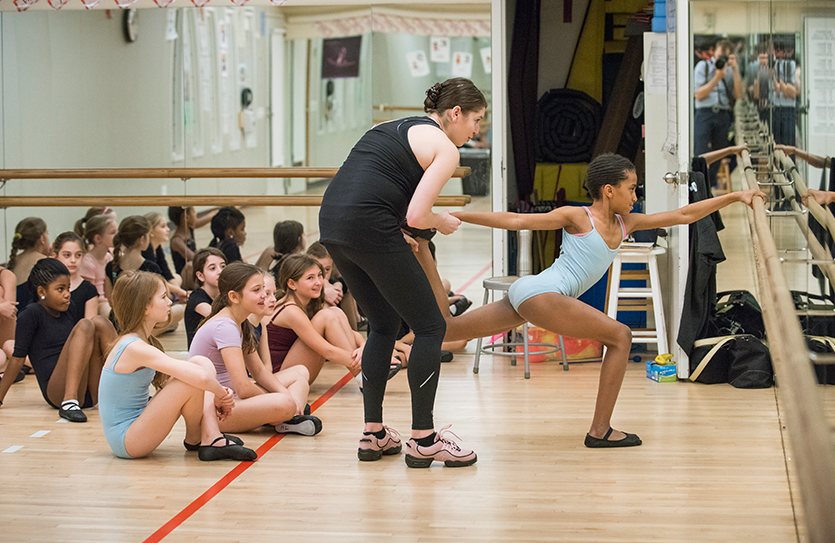 Students learn about the language of dance and the art of movement in the dance studio.