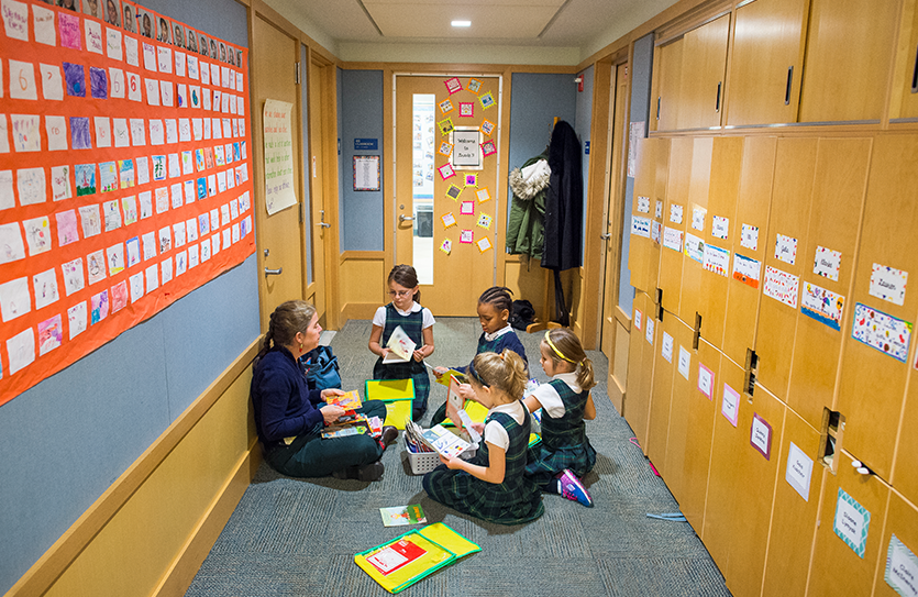 Small groups find comfortable spaces throughout the school to read.