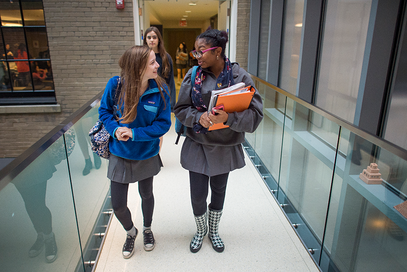 Students cross the connecter and enter the Upper School home in the Townhouse.