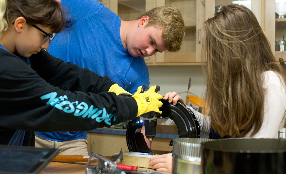 Eigth graders make their bio-char stoves for their trip to Costa Rica.