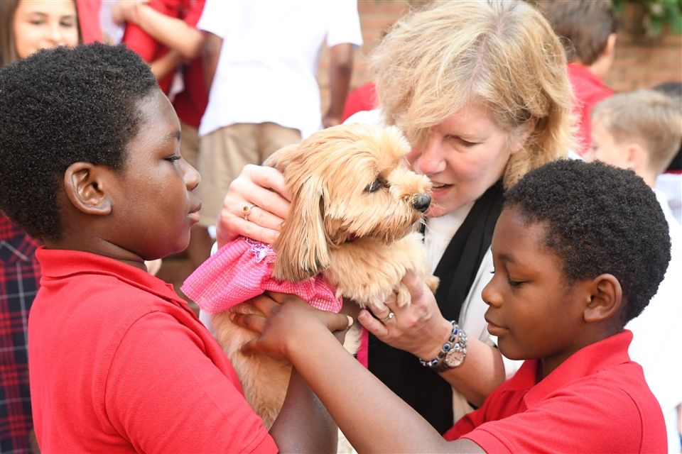 Lower School students petting dog - St. Andrew's Episcopal School