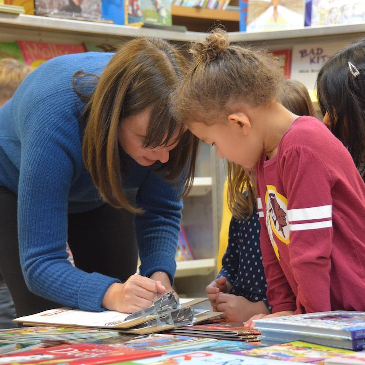 Teacher working closely with Lower School student - St. Andrew's Episcopal School
