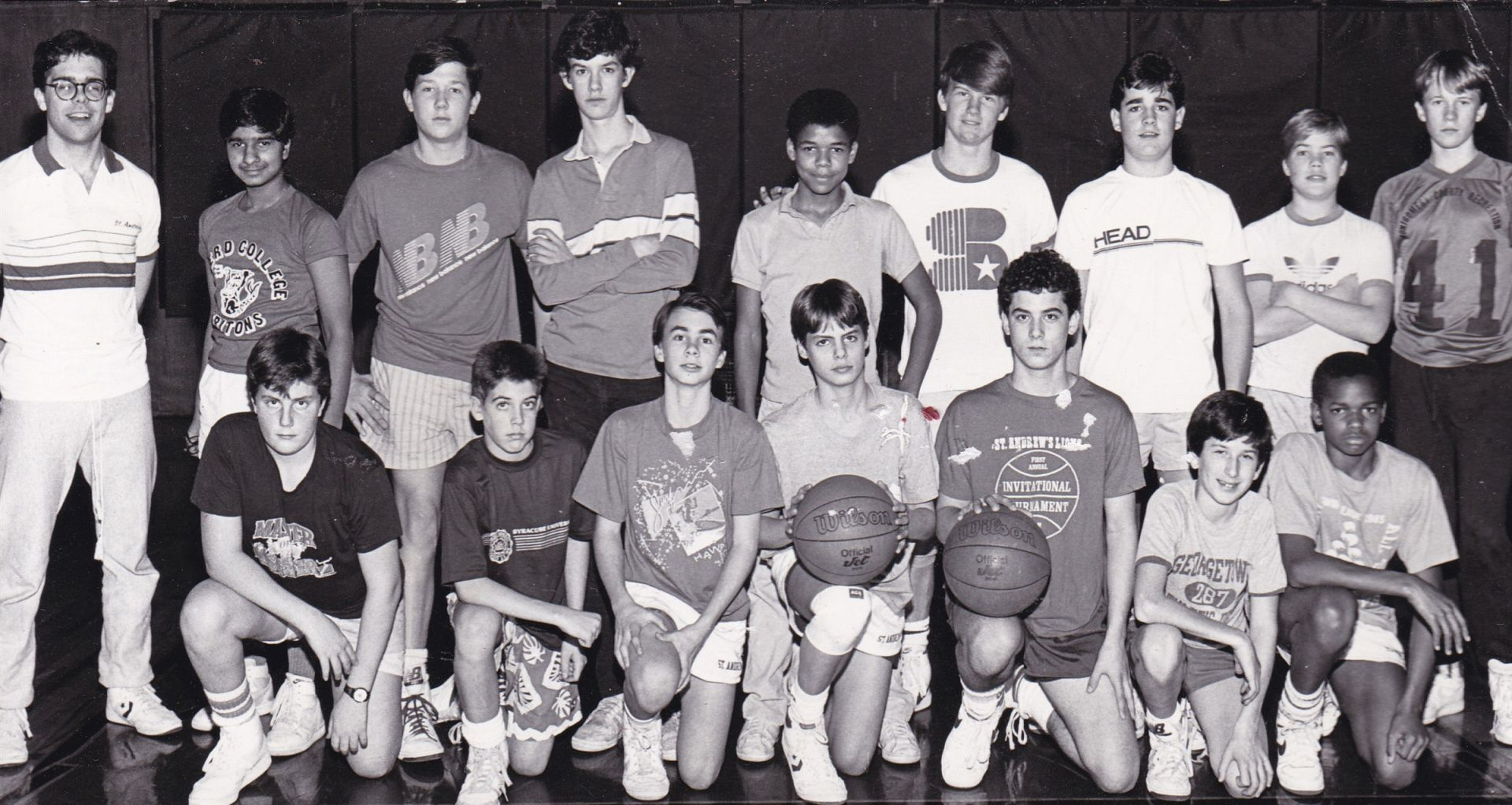 Students posing for team basketball photo - St. Andrew's Episcopal School