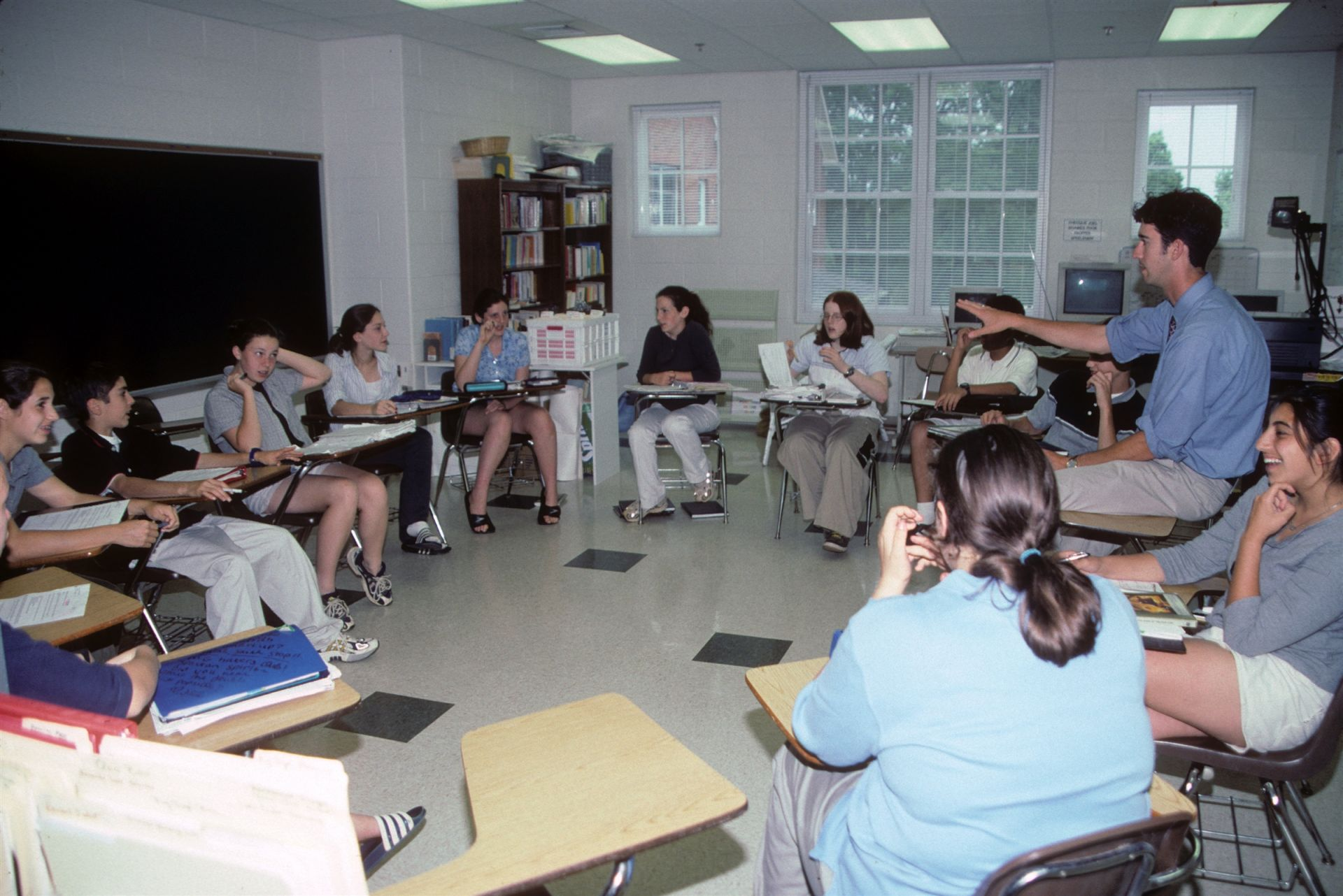 Teacher speaking with students in a group setting - St. Andrew's Episcopal School