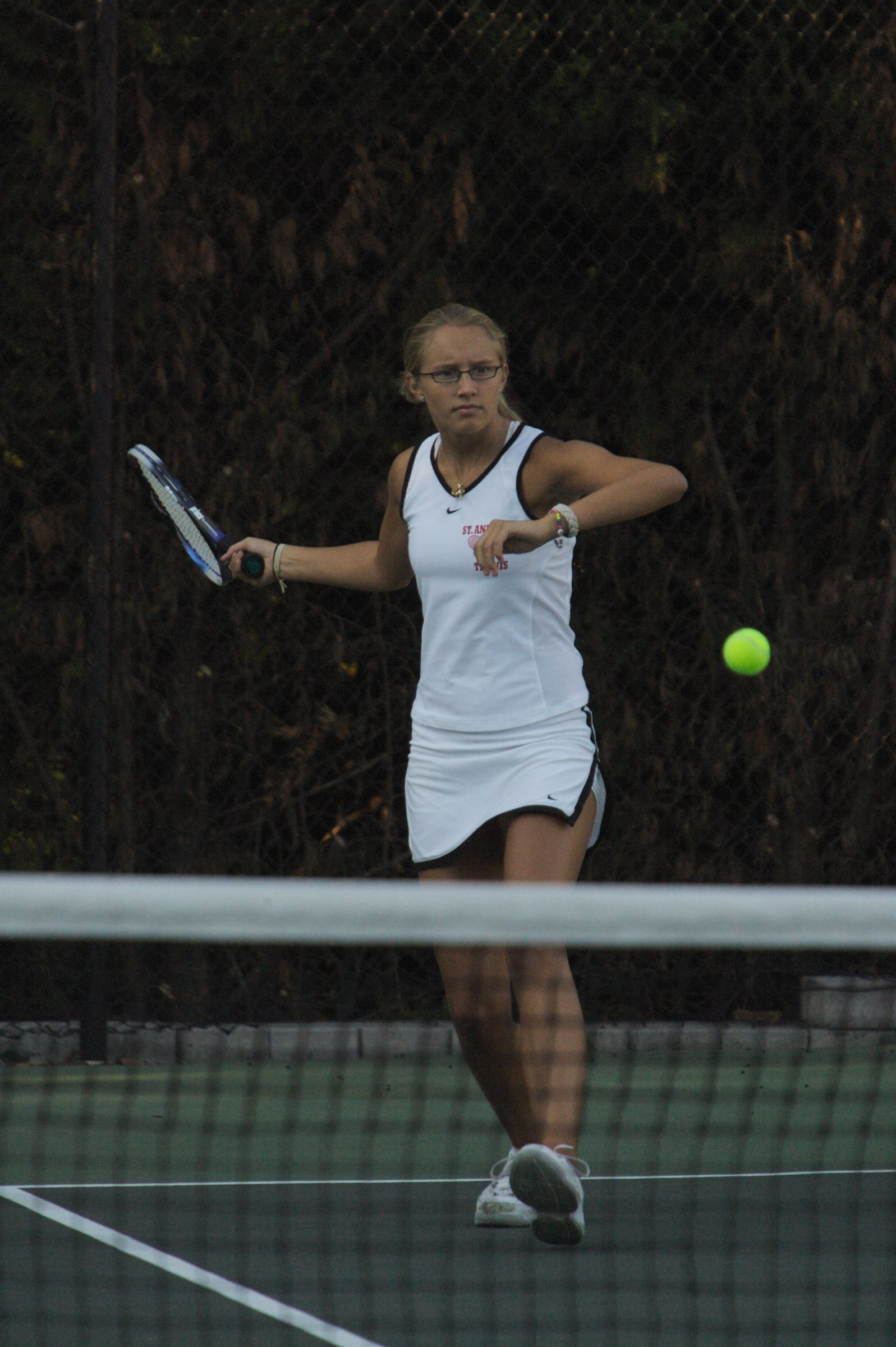 Student on Girls Tennis team during match - St. Andrew's Episcopal School