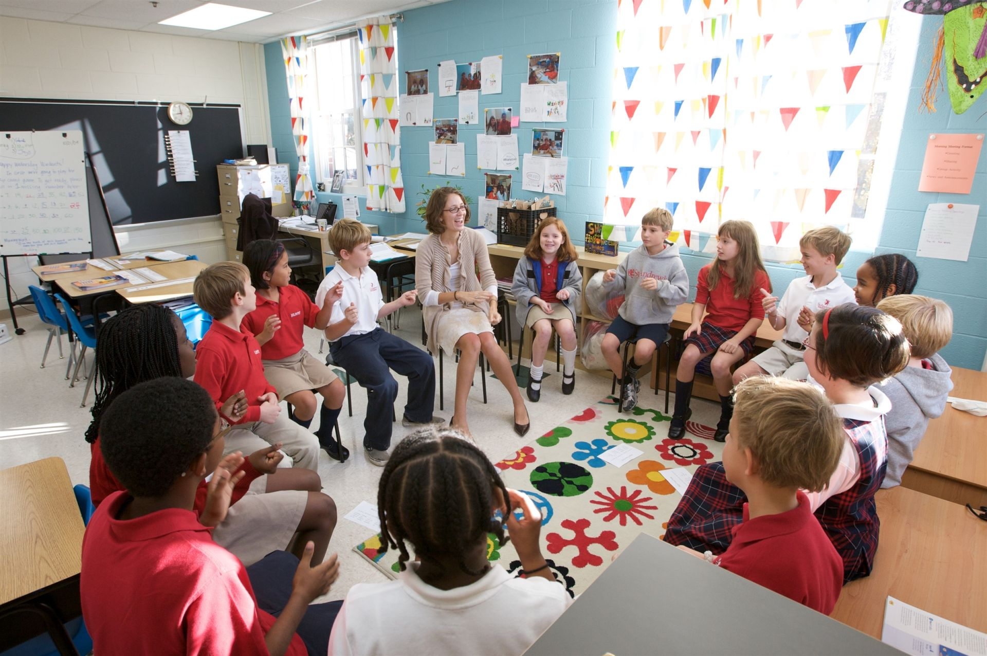 Lower School students gathering in a circle with teacher - St. Andrew's Episcopal School