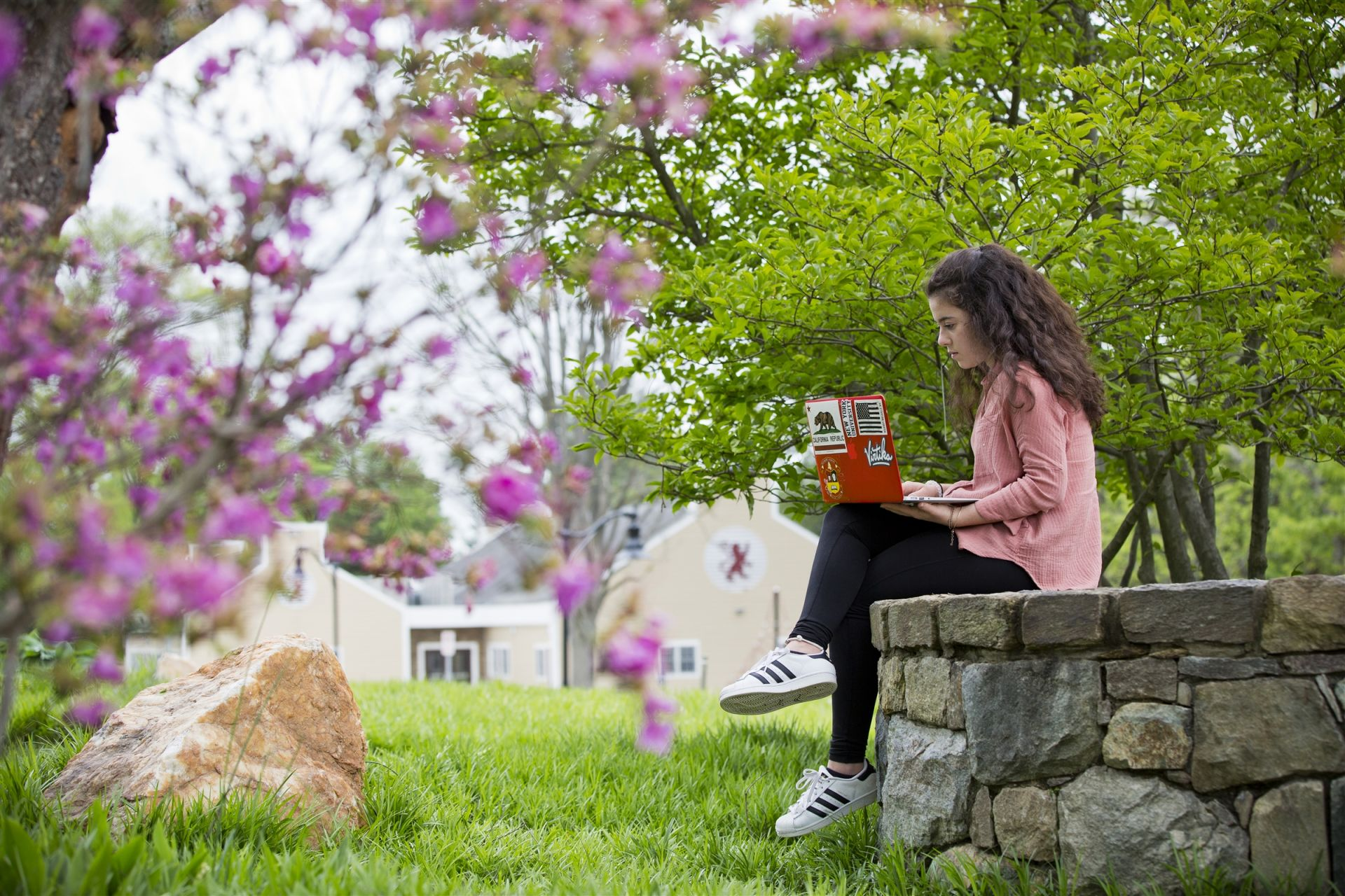 Student sitting on campus - St. Andrew's Episcopal School
