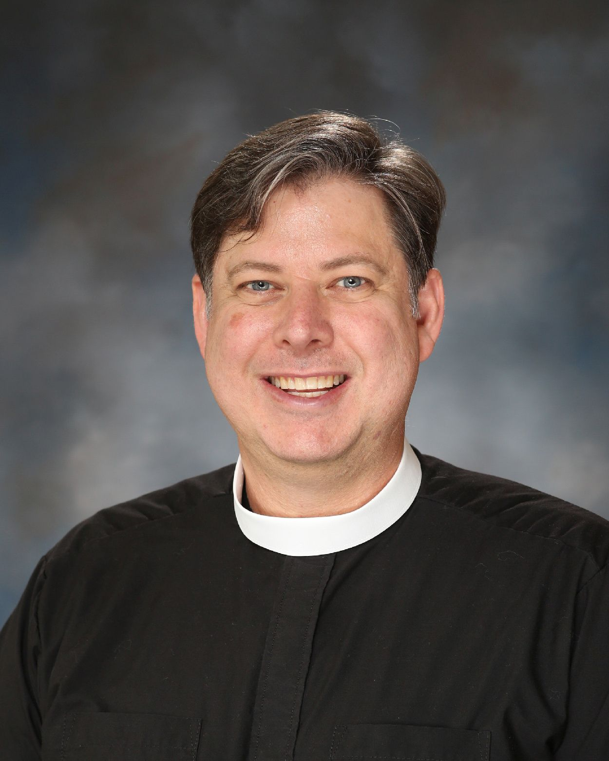 The Rev. James Isaacs, Chaplain to the Middle and Upper Schools