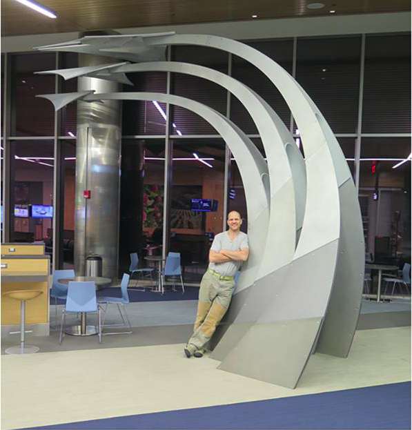 Jacob Kulin with his work<i>Flyboy</i> at Logan International Airport in Boston, MA.