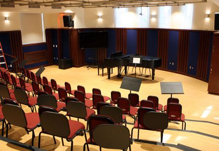 Our newly renovated state-of-the-art choral music room features tiered-seating, choral standard seats, and a professional sound and lighting board.