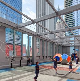 An open-topped rooftop playground offers a safe recreation area for younger students