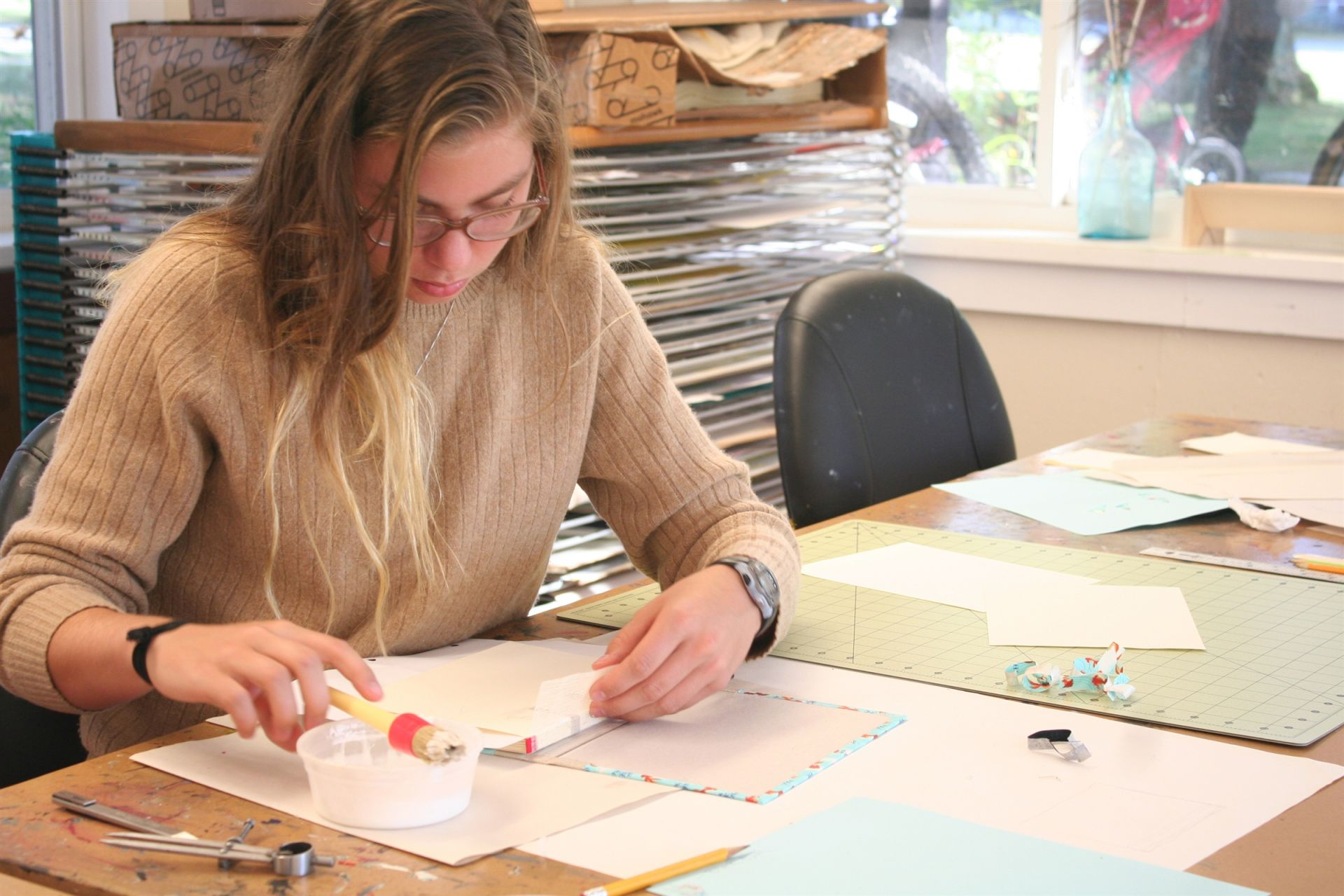 Senior Lucy Ward working on her bookbinding project