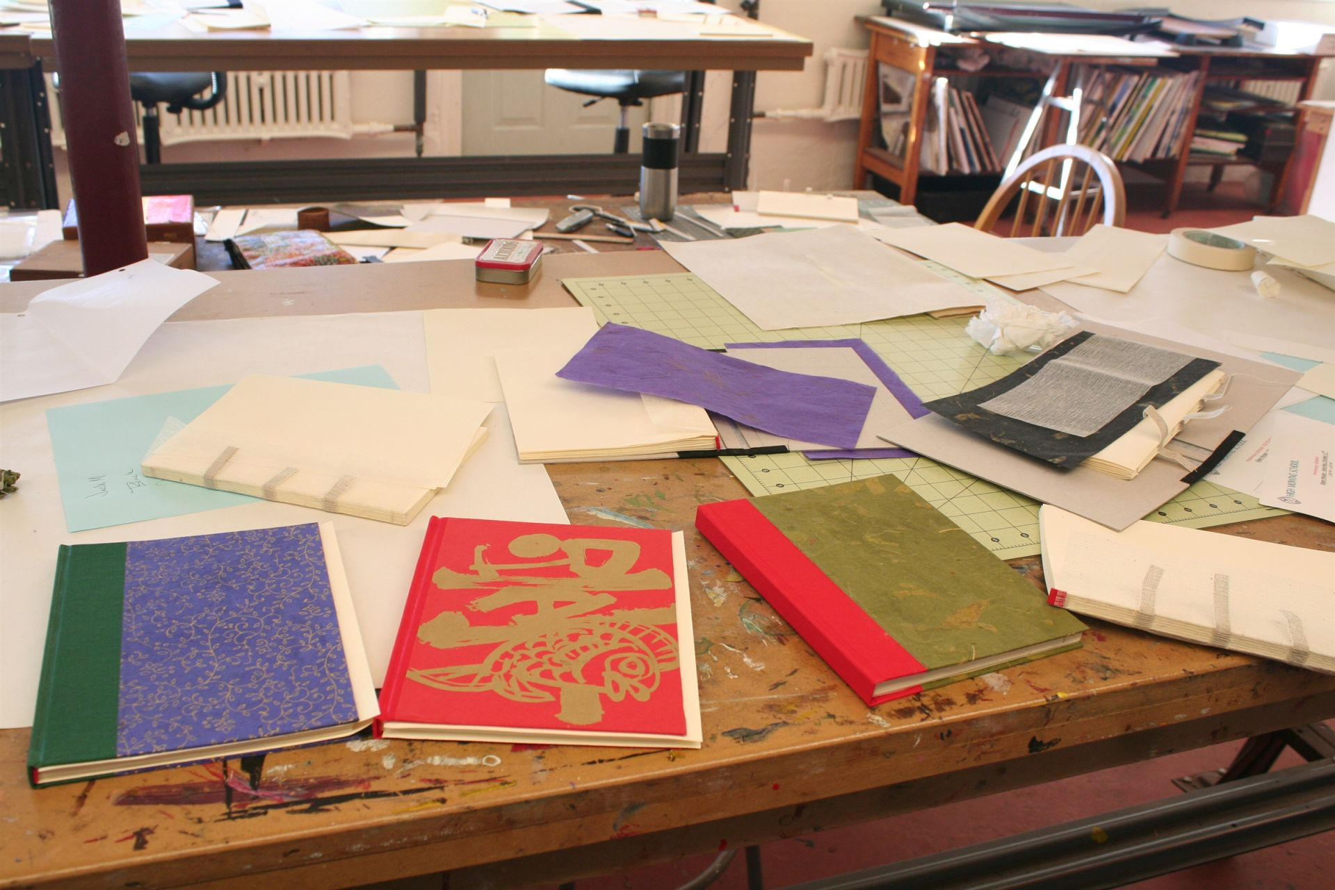 Bookbinding projects at various stages of completion