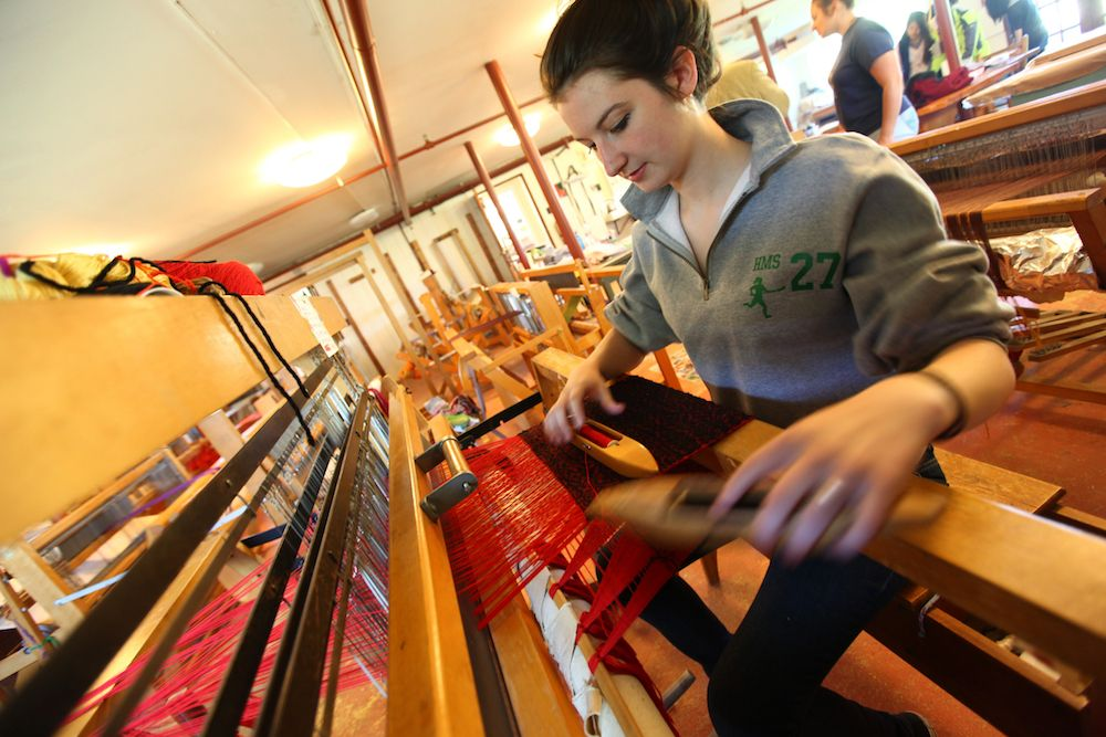 HMS students learn to weave on the many looms in the Textiles Studio