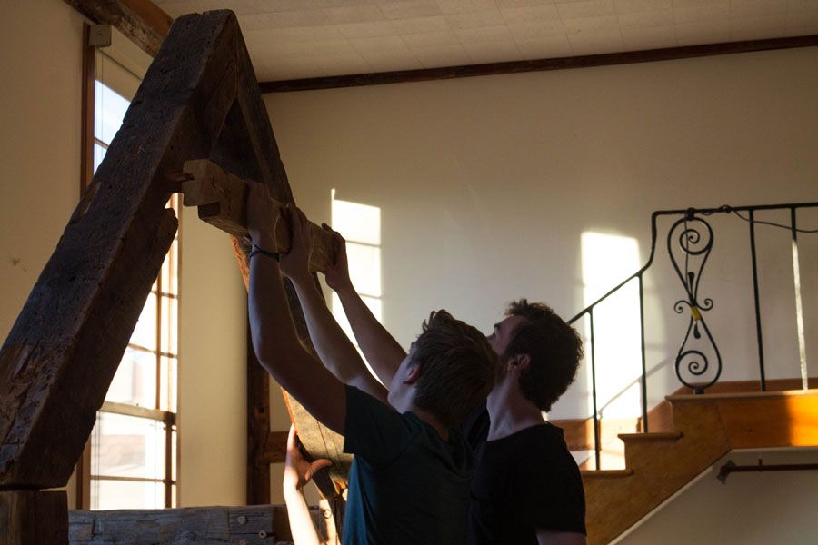 Adam Hill '17 and Keiran Sass '17 assembling the crèche for the upcoming Nativity performance.