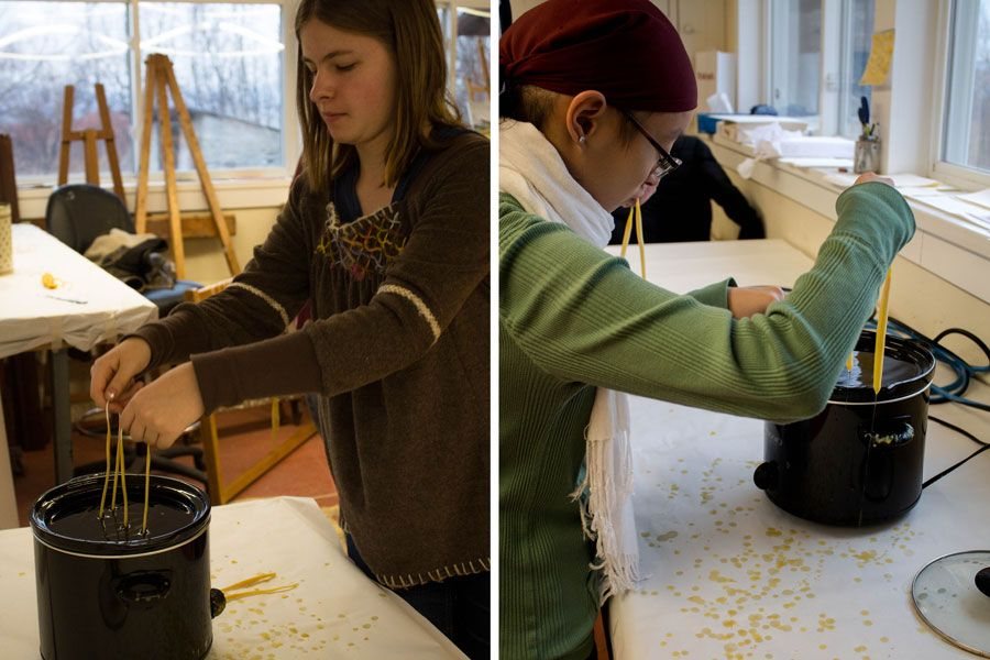 Amelia Metcalfe '17 and Kayla Quigley '18's candles begin to take shape after repeating the dipping and cooling process.