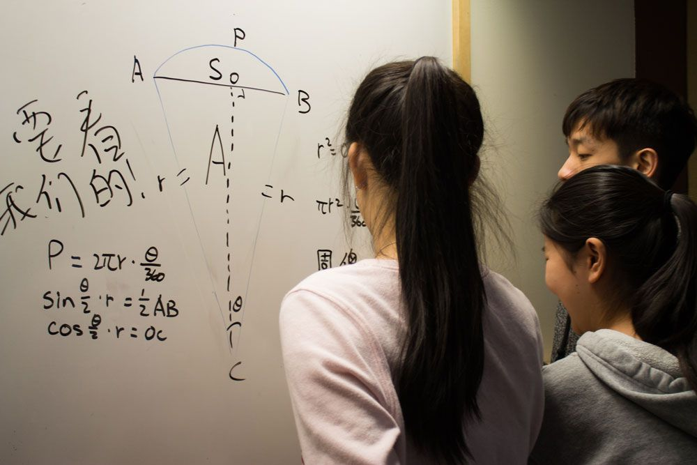 Suky Hu '17, Alice Wang '17 and Jerry Zhou '17 puzzle over part of their study prep.