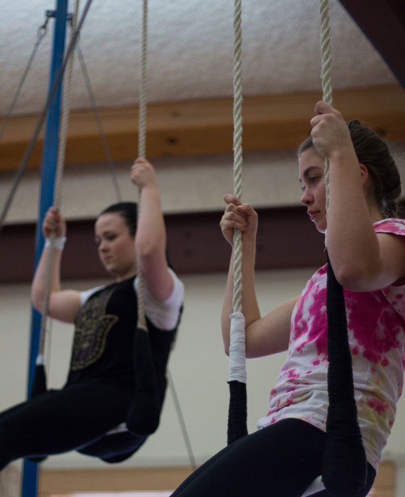Sephirah Bullard '18 and Lucy Ward '19 wait for instruction from the circus instructor.