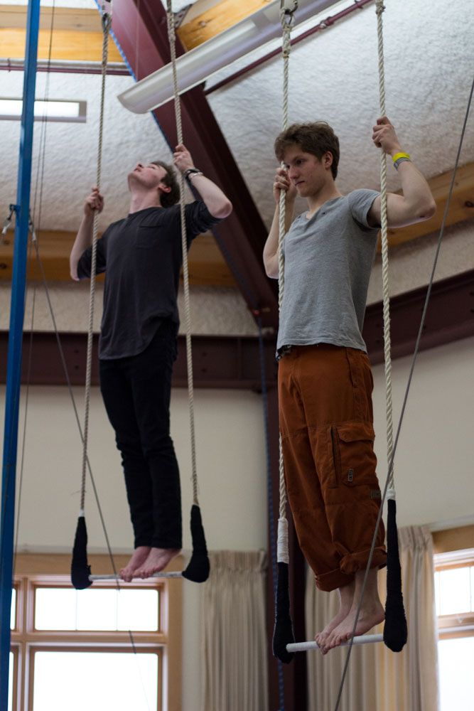 Keiran Sass '17 and Jonathan O'Connors '17 practice standing on the trapeze in the Center Room of the Science Building.
