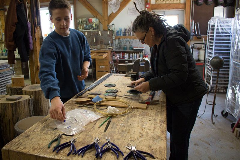 Andrew Ewald '17 works with Material Arts teacher Michael Noer during open studios to create a sword as his final art project for the junior classes' Parzival Block.