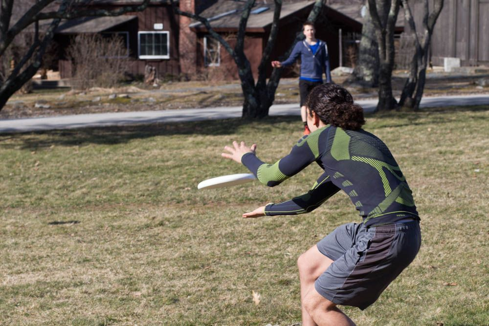 Hunab Almehua '18 catches a pass from Andrew Ewald '17. This year the Ultimate Frisbee team will be playing other local schools for the first time in HMS history.