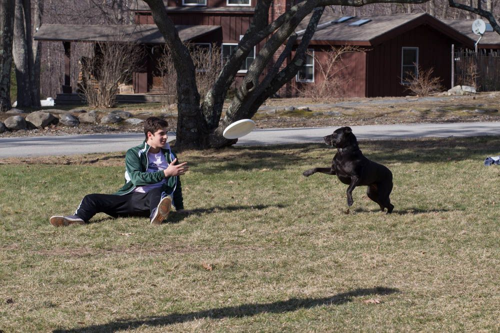 Alvaro Puentes Gomez '17 and a neighbor's dog - this four legged friend was very eager to play!