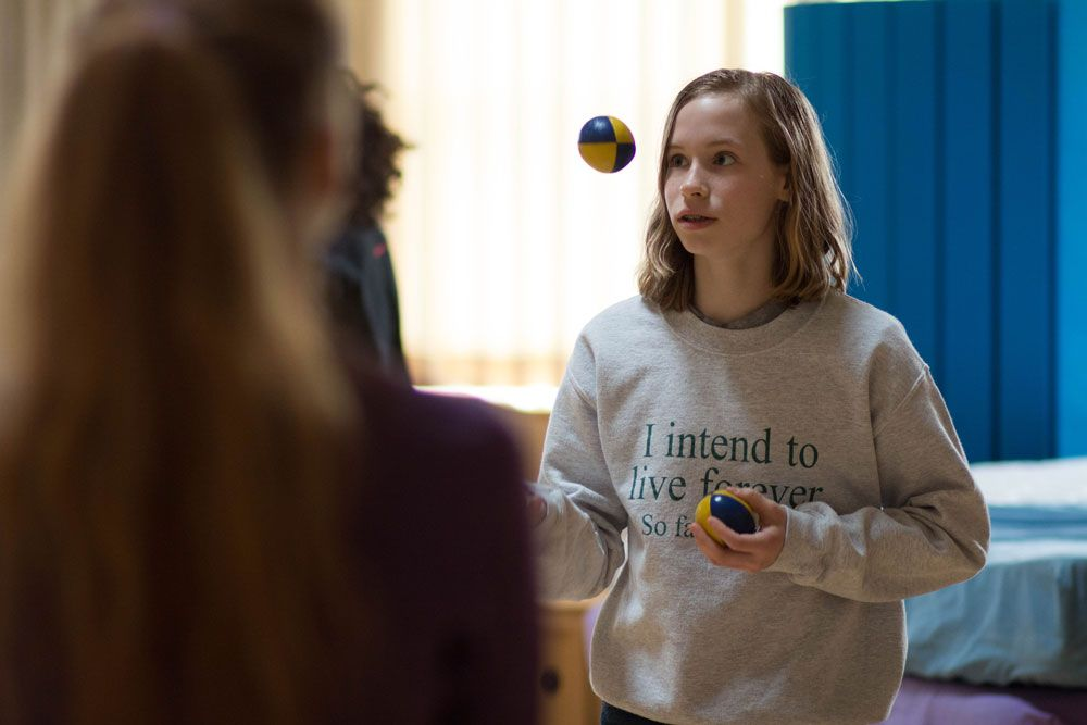 Alise Kaplan '19 tries to coordinate a pass with a classmate while keeping her balls juggling. Juggling is currently being offered as an option for our pre-class Morning Activity time slot.