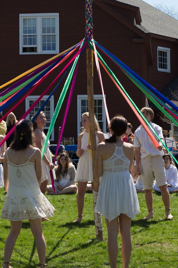 Members of the senior class who participated in Morris Dancing get the opportunity to weave the may pole once the King and Queen of spring have successfully chased off Father Winter.