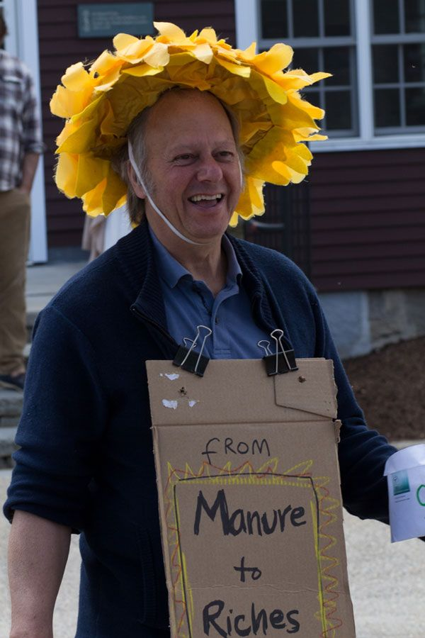 Math & Humanities teacher Robert Sim wears a sunflower hat while selling