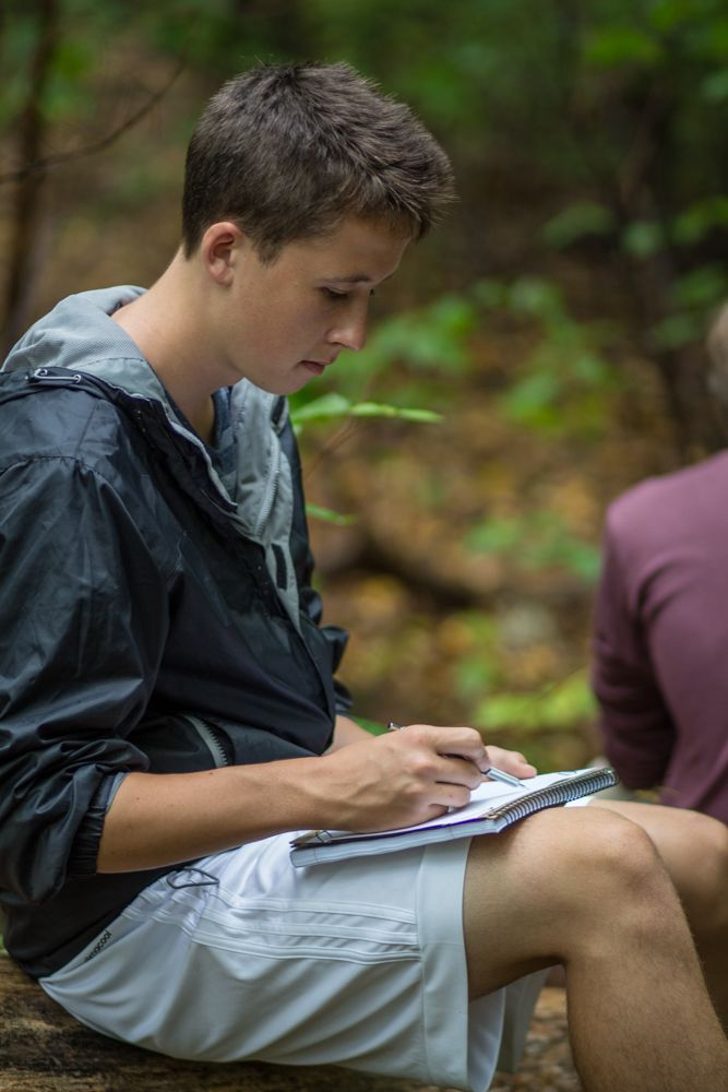 Seated on a broken log, Andrew Ewald '17 sketches the forest around him. Tasked with observing the flora through the lens of their class and studies, each member of the class silently worked in their journals sketching and noting the natural curiosities of the forest.