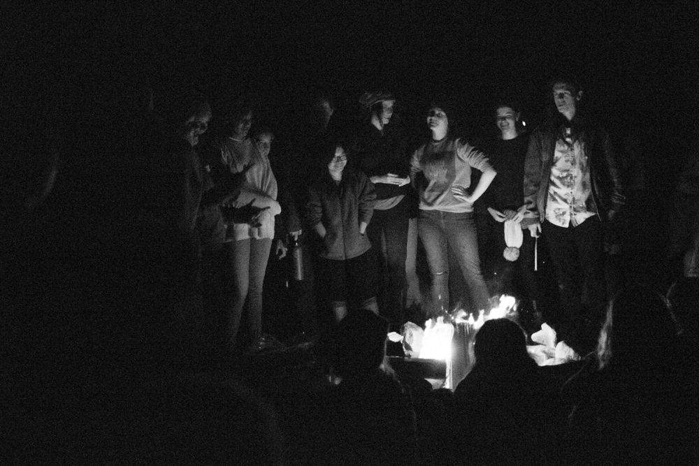 HMS students singing around the fire. Each Waldorf school convened at the Rudolf Steiner School of Ann Arbor's camp for singing, stories, and drums around the fire.