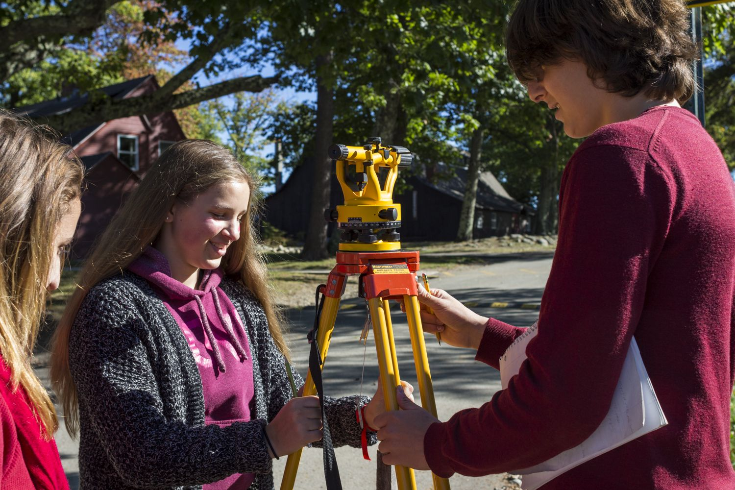 Fiona Kennedy '19 and Rye Fought '19 calibrate a sight line level while they try to accurately map the Oval in their Surveying + Trigonometry Block Class.