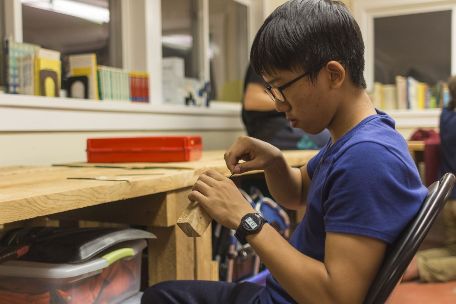 David Jiao '20 works to file out the tang housing for what will be a handmade full tang Swedish fixed blade knife. Knife Making is a new course for the 2016-17 school year and is offered as an evening course.