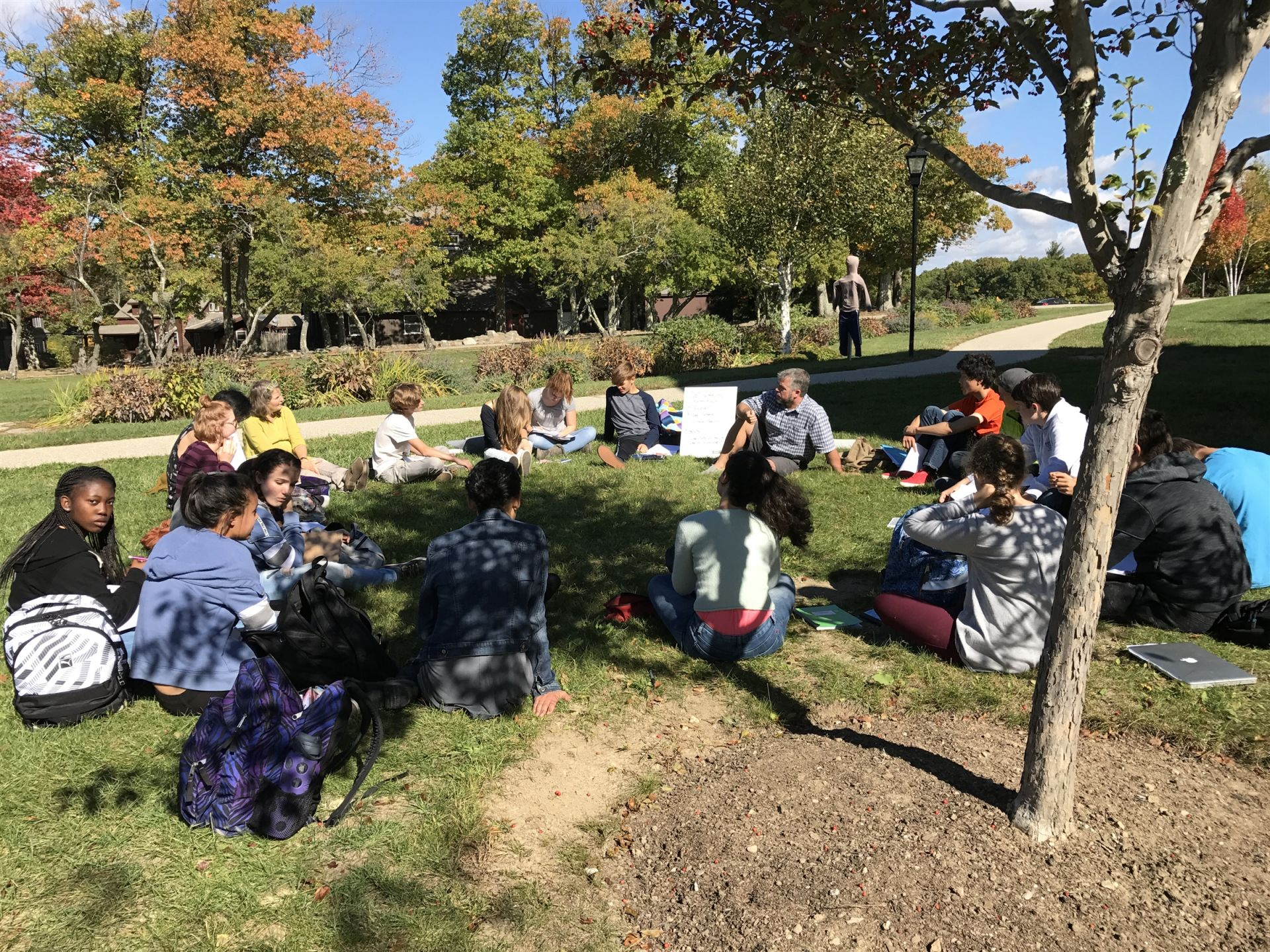 Science Teacher Rob Yeomans took his Plant Chemistry block lecture outside today during this unseasonably warm week!