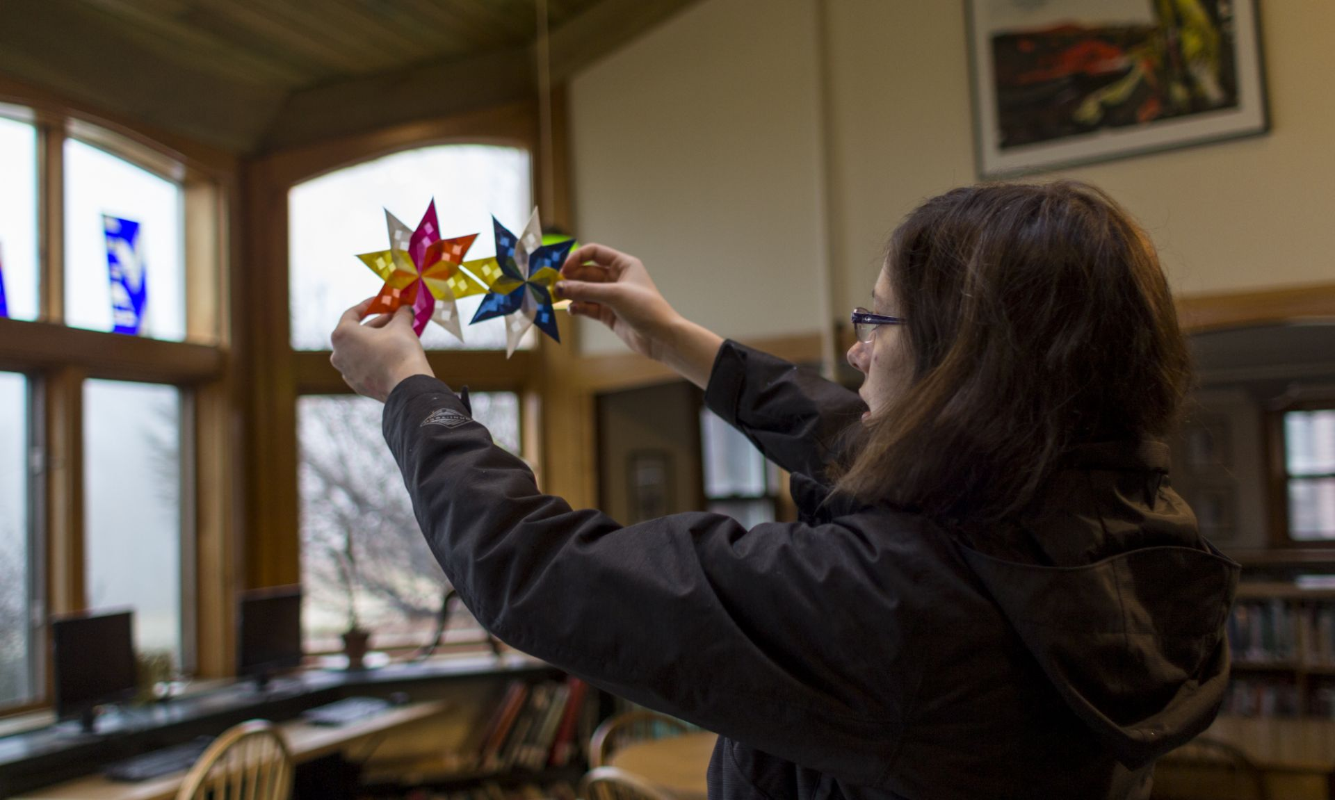 Audrey Quick '17 holds up completed window stars during her afternoon Holiday Activity.