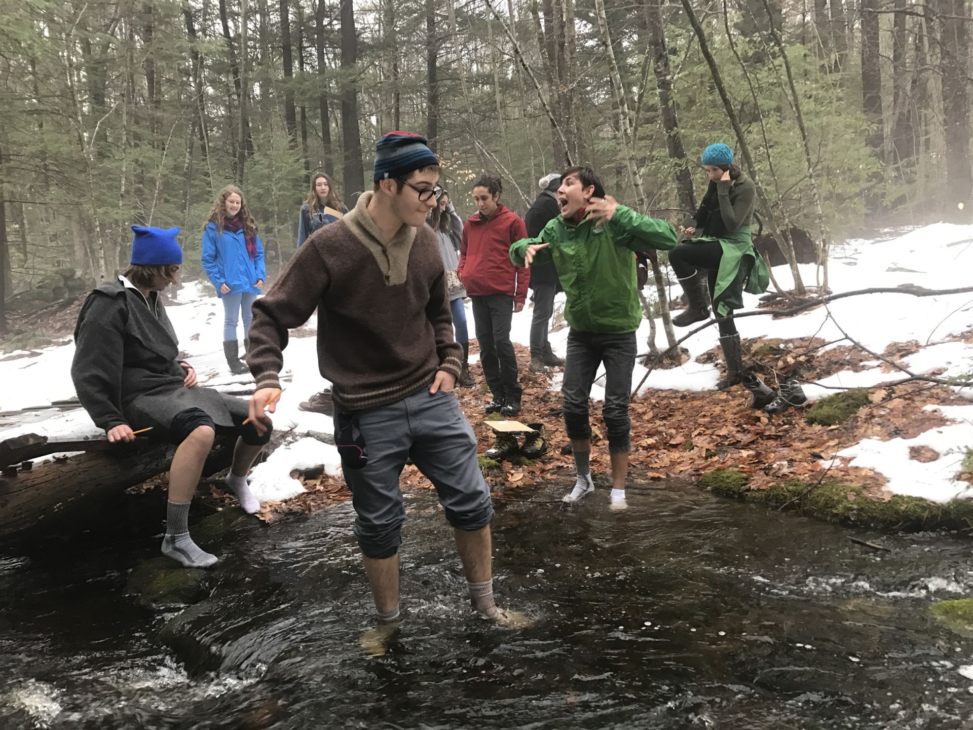 The afternoon Winter Ecology Class gets their feet wet testing the insulative values of wool socks vs. cotton socks.