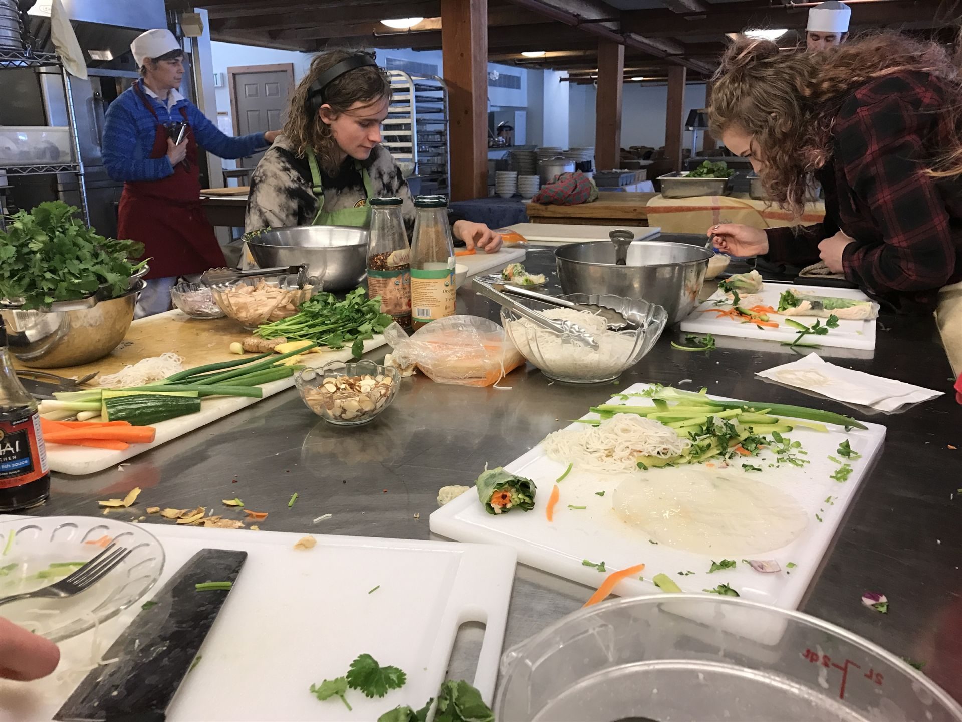 The afternoon culinary class cooks up some Thai rolls under the instruction of head chef Evan Fielding.