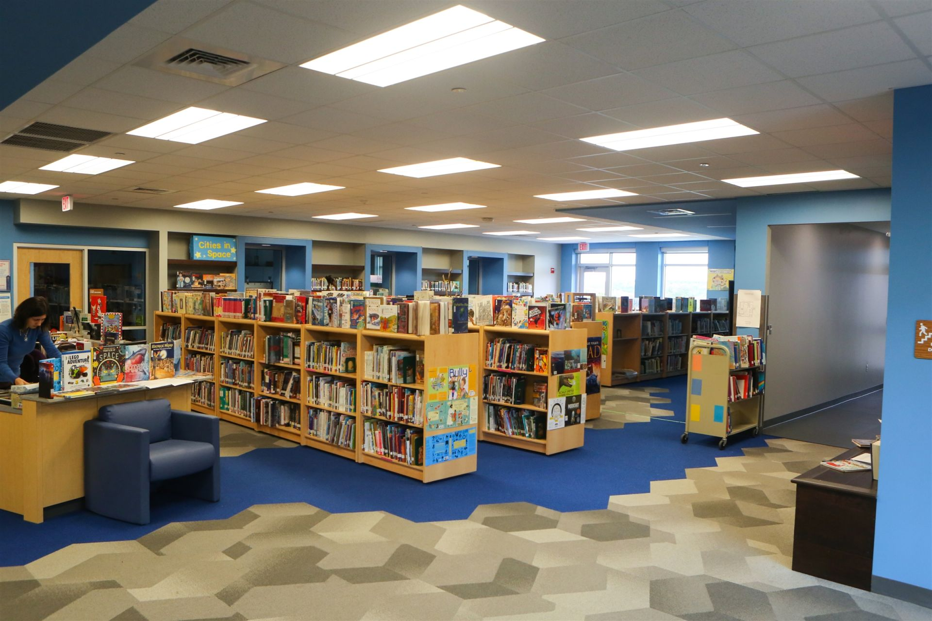 The Library at St. Gabriel's Catholic School is designed to encourage students to become self-directed lifelong learners and active, independent, effective users of information and literature. The Library showcases a diverse collection of both print and non-print materials that are maintained to support the curriculum, interests, and needs of the St. Gabriel's community. Additionally, the Library is designed with reading nooks and a gathering space for students to participate in story time or work on group projects together.