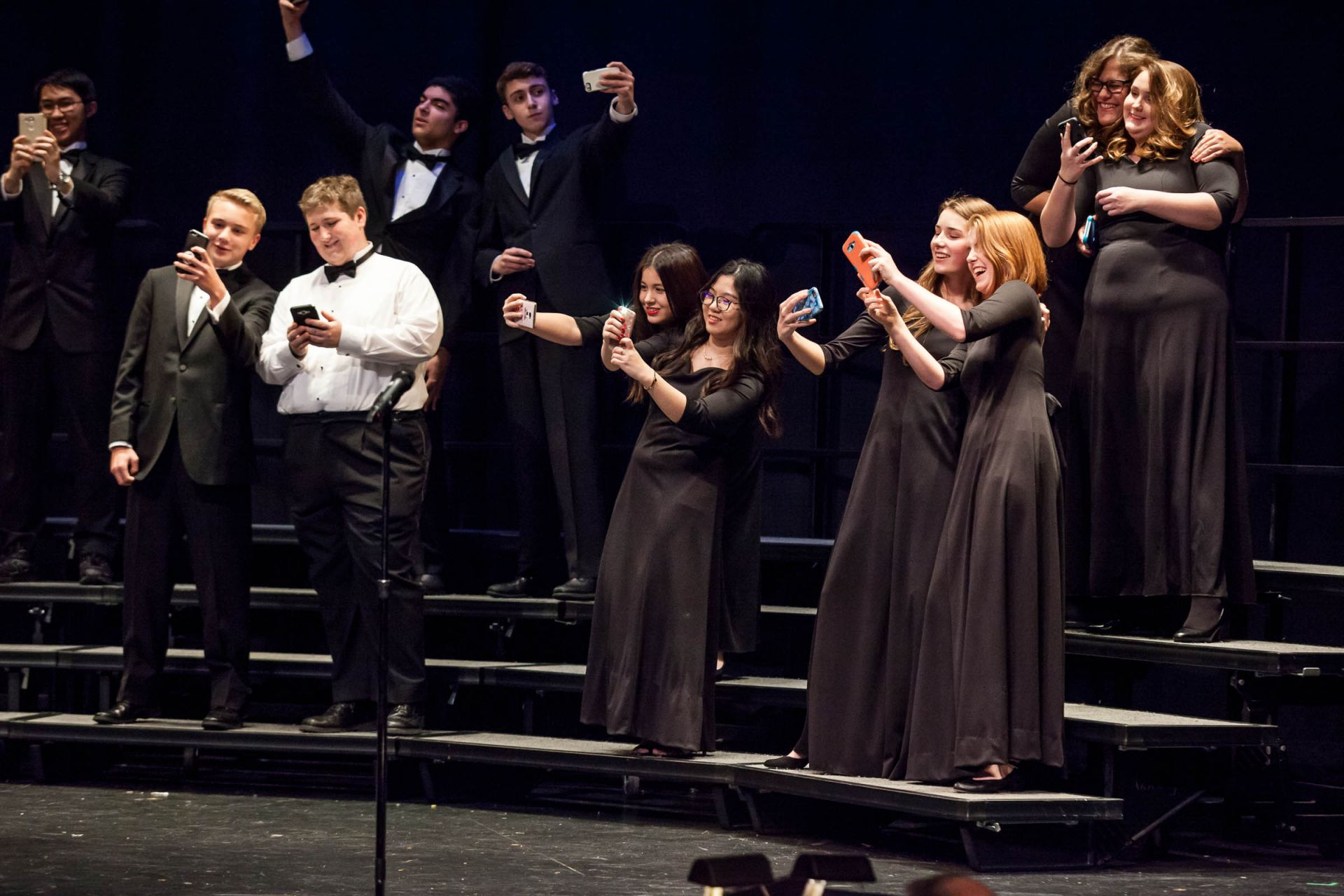 Never far from their phones, upper school students even used the devices as props during the Winter Concert.