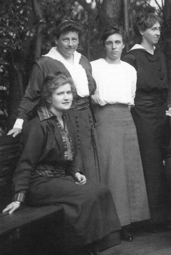 Katherine Delmar Burke (second from left) with her teachers at the school's original location on Broderick Street.