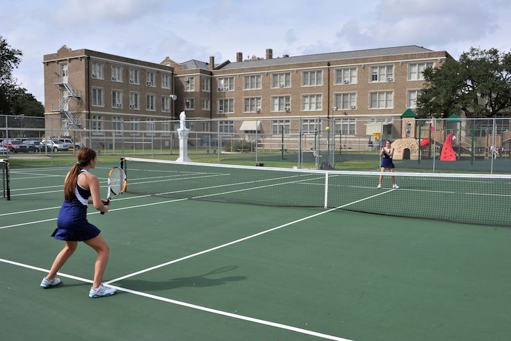 High school and elementary school students enjoy having two refurbished tennis courts on campus.