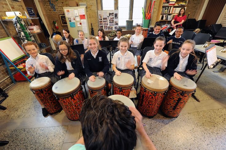Students explore the instruments, rhythms and sounds of different cultures in music class.