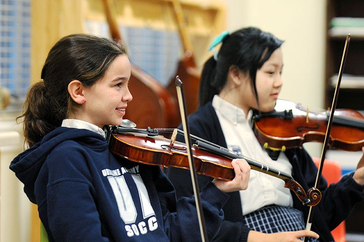Students learn techniques for playing the violin, cello, viola and bass in the Orchestra Program.