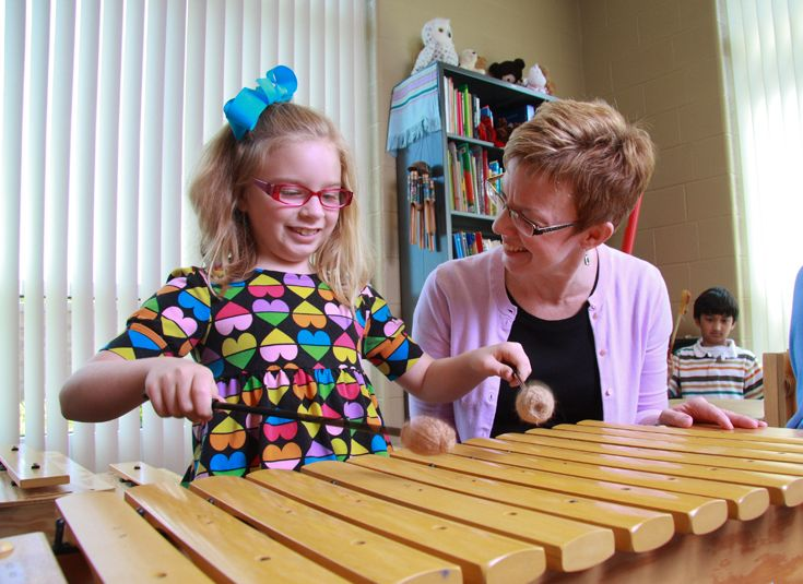 Playing xylophones in lower school music class