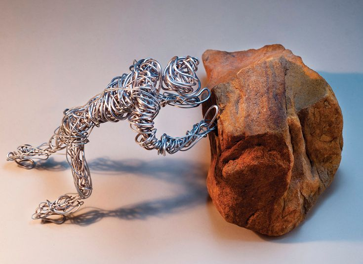 Handshaped wire and stone sculpture by Eliah Hiken '14.