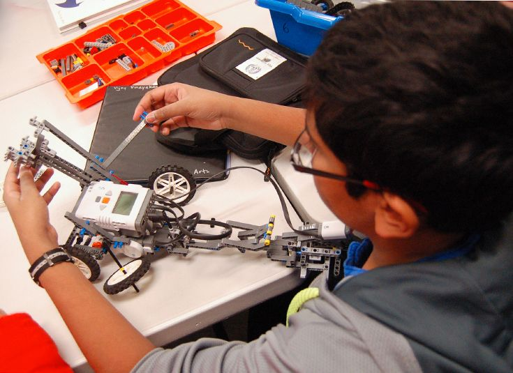 Sixth graders build their own robots in the Fab Lab.