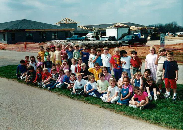 Kindergartners in front of new construction in 1998.