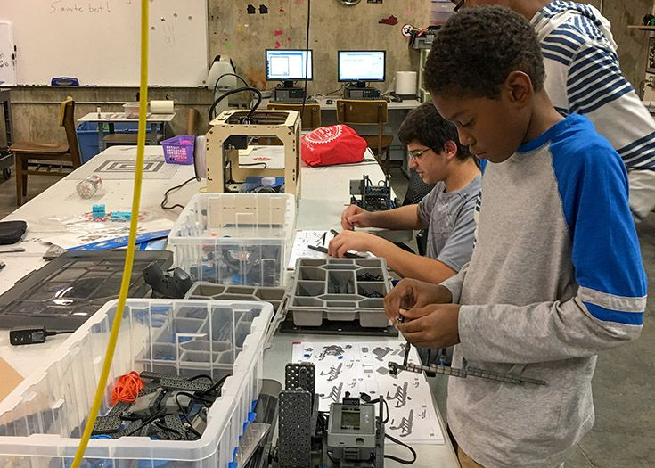 Middle schoolers assemble their robots in Programming and Robotics.