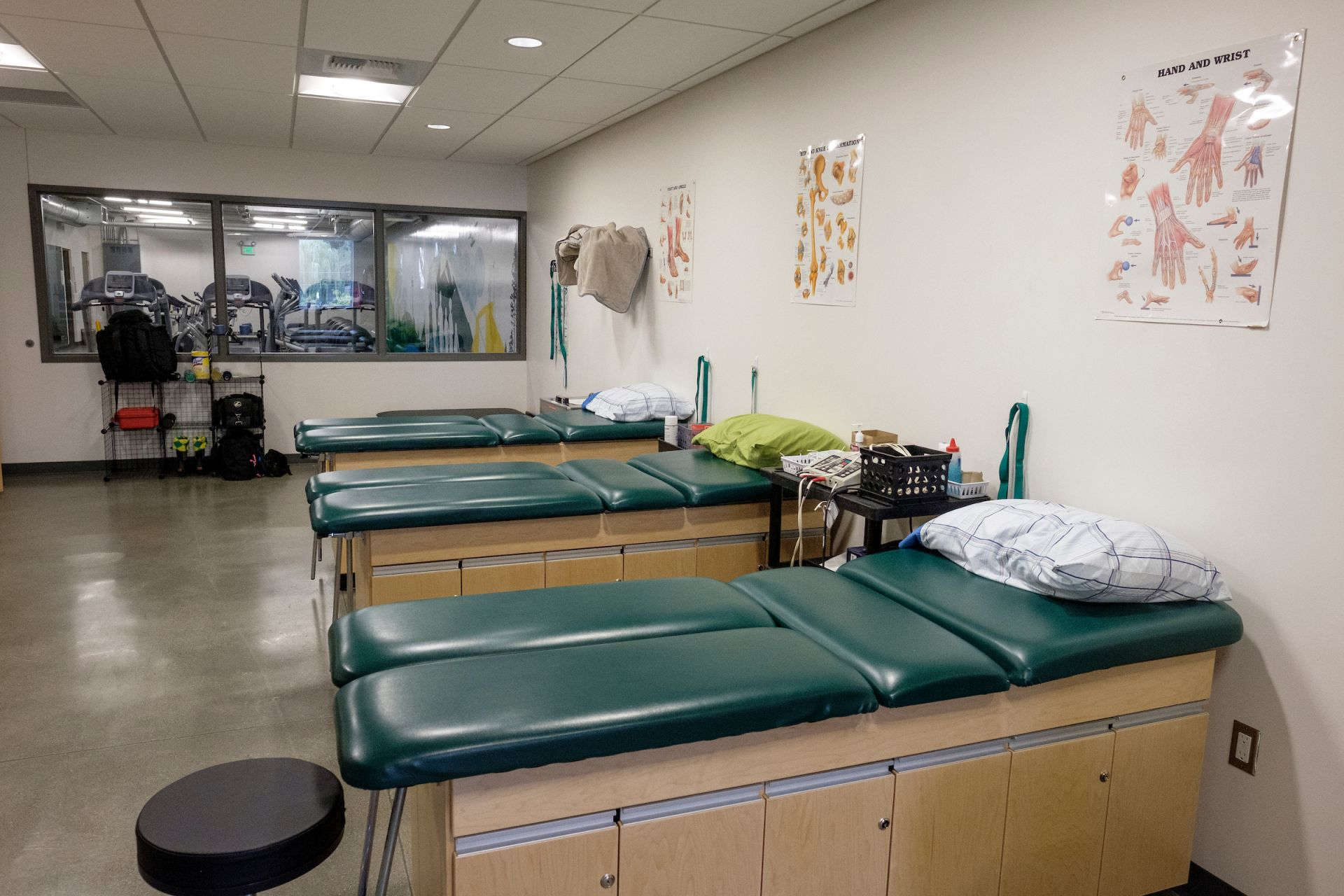 The athletic training room, featuring multiple treatment beds and rehab tools, is put to good use both by our athletes recovering from injury as well as students learning sports medicine.