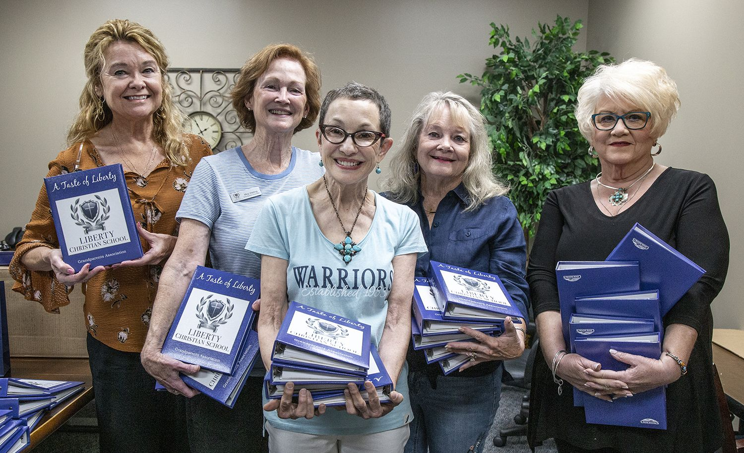Grandparents Association Cookbook Committee members get ready to distribute cookbooks